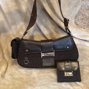 Brown Canvas Dior handbag and wallet.